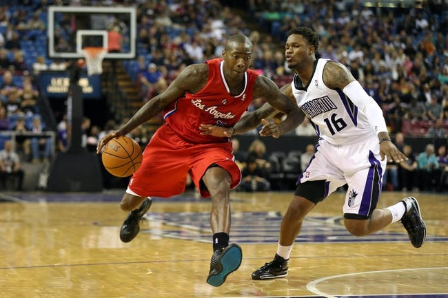Oct 14, 2013; Sacramento, CA, USA; Los Angeles Clippers shooting guard Jamal Crawford (11) drives in against Sacramento Kings shooting guard Ben McLemore (16) during the second quarter at Sleep Train Arena. Mandatory Credit: Kelley L Cox-USA TODAY Sports