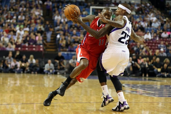 Oct 14, 2013; Sacramento, CA, USA; Los Angeles Clippers shooting guard Jamal Crawford (11) drives in against Sacramento Kings point guard Isaiah Thomas (22) during the second quarter at Sleep Train Arena. Mandatory Credit: Kelley L Cox-USA TODAY Sports