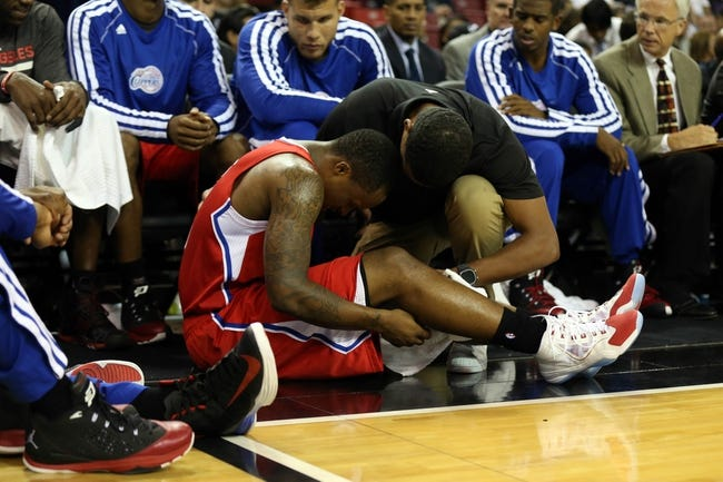 Oct 14, 2013; Sacramento, CA, USA; Los Angeles Clippers point guard Maalik Wayns (5) speaks with a trainer on the sideline during the second quarter against the Sacramento Kings at Sleep Train Arena. Mandatory Credit: Kelley L Cox-USA TODAY Sports