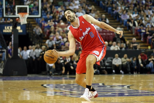Oct 14, 2013; Sacramento, CA, USA; Los Angeles Clippers center Byron Mullens (0) passes the ball against the Sacramento Kings during the second quarter at Sleep Train Arena. Mandatory Credit: Kelley L Cox-USA TODAY Sports