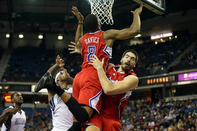 Oct 14, 2013; Sacramento, CA, USA; Los Angeles Clippers small forward Brandon Davies (8) collides into center Byron Mullens (0) trying to gather the rebound against Sacramento Kings center DeMarcus Cousins (15) during the second quarter at Sleep Train Arena. Mandatory Credit: Kelley L Cox-USA TODAY Sports