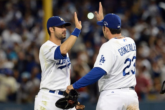 October 14, 2013; Los Angeles, CA, USA; Los Angeles Dodgers center fielder Andre Ethier (16) and first baseman Adrian Gonzalez (23) celebrate the 3-0 victory against the St. Louis Cardinals following game three of the National League Championship Series baseball game at Dodger Stadium. Mandatory Credit: Jayne Kamin-Oncea-USA TODAY Sports