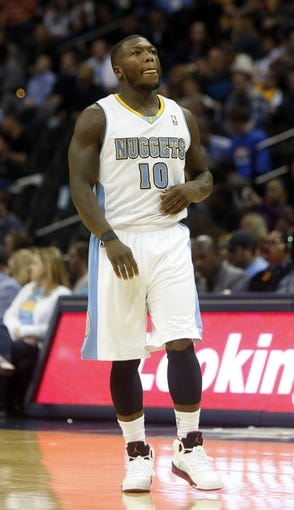 Oct 14, 2013; Denver, CO, USA; Denver Nuggets guard Nate Robinson (10) during the second half against the San Antonio Spurs at Pepsi Center. The Nuggets won 98-94. Mandatory Credit: Chris Humphreys-USA TODAY Sports