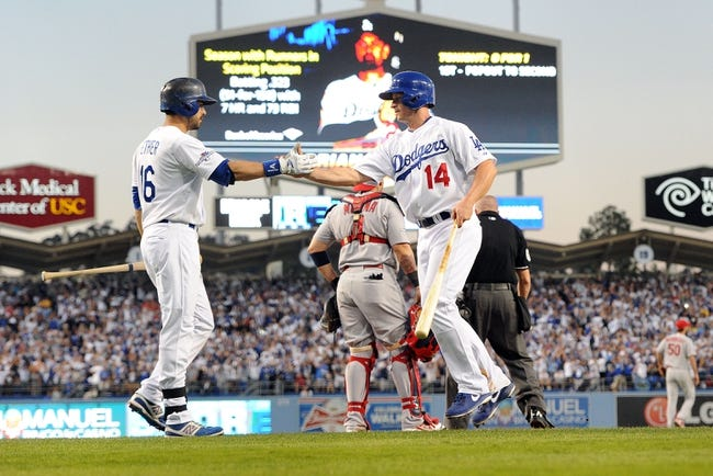 October 14, 2013; Los Angeles, CA, USA; Los Angeles Dodgers second baseman Mark Ellis (14) celebrates with center fielder Andre Ethier (16) after scoring a run in the fourth inning against the St. Louis Cardinals in game three of the National League Championship Series baseball game at Dodger Stadium. Mandatory Credit: Jayne Kamin-Oncea-USA TODAY Sports