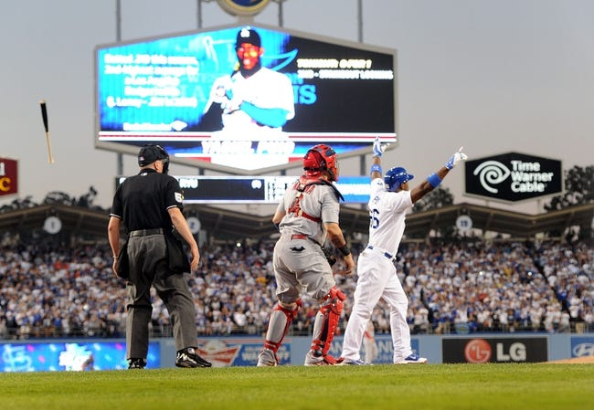 October 14, 2013; Los Angeles, CA, USA; Los Angeles Dodgers right fielder Yasiel Puig (66) reacts after hitting an RBI triple in the fourth inning against the St. Louis Cardinals in game three of the National League Championship Series baseball game at Dodger Stadium. Mandatory Credit: Jayne Kamin-Oncea-USA TODAY Sports