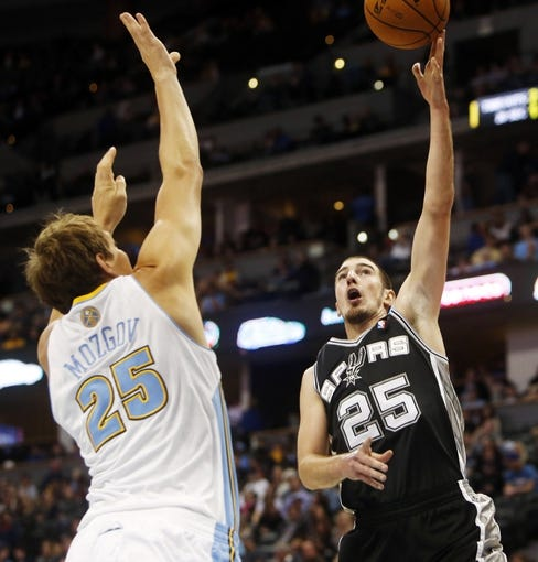 Oct 14, 2013; Denver, CO, USA; San Antonio Spurs guard Nando De Colo (25) shots the ball during the second half against the Denver Nuggets at Pepsi Center. The Nuggets won 98-94. Mandatory Credit: Chris Humphreys-USA TODAY Sports