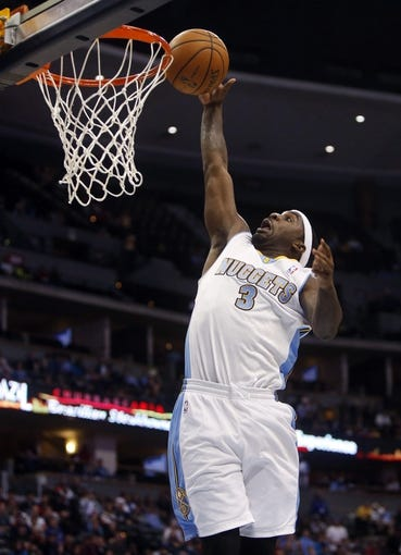 Oct 14, 2013; Denver, CO, USA; Denver Nuggets guard Ty Lawson (3) drives to the basket during the second half against the San Antonio Spurs at Pepsi Center. The Nuggets won 98-94. Mandatory Credit: Chris Humphreys-USA TODAY Sports