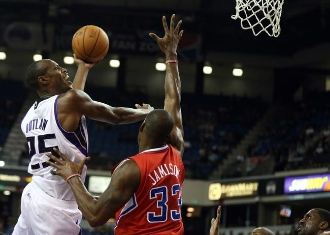Oct 14, 2013; Sacramento, CA, USA; Sacramento Kings small forward Travis Outlaw (25) shoots the ball above Los Angeles Clippers power forward Antawn Jamison (33) during the fourth quarter at Sleep Train Arena. The Sacramento Kings defeated the Los Angeles Clippers 99-88. Mandatory Credit: Kelley L Cox-USA TODAY Sports