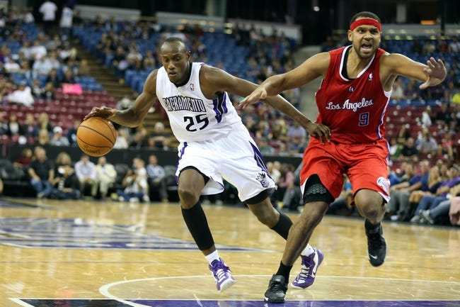Oct 14, 2013; Sacramento, CA, USA; Los Angeles Clippers shooting guard Jared Dudley (9) calls for the offensive foul by Sacramento Kings small forward Travis Outlaw (25) during the fourth quarter at Sleep Train Arena. The Sacramento Kings defeated the Los Angeles Clippers 99-88. Mandatory Credit: Kelley L Cox-USA TODAY Sports