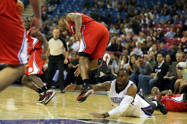 Oct 14, 2013; Sacramento, CA, USA; Sacramento Kings shooting guard Marcus Thornton (23) reaches for the loose ball against Los Angeles Clippers shooting guard Willie Green (34) during the fourth quarter at Sleep Train Arena. The Sacramento Kings defeated the Los Angeles Clippers 99-88. Mandatory Credit: Kelley L Cox-USA TODAY Sports