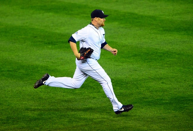 Oct 15, 2013; Detroit, MI, USA;  Detroit Tigers relief pitcher Phil Coke (40) comes into pitch during the ninth inning against the Boston Red Sox in game three of the American League Championship Series baseball game at Comerica Park. Mandatory Credit: Andrew Weber-USA TODAY Sports