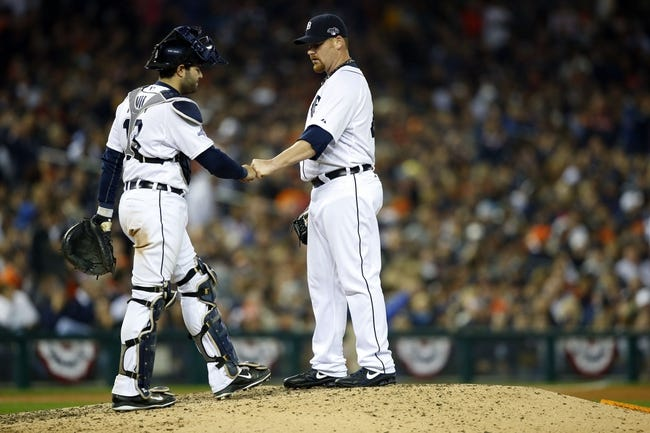 Oct 15, 2013; Detroit, MI, USA;  Detroit Tigers relief pitcher Phil Coke (40) fist bumps catcher Alex Avila (13) during the ninth inning in game three of the American League Championship Series baseball game against the Boston Red Sox at Comerica Park. Mandatory Credit: Rick Osentoski-USA TODAY Sports