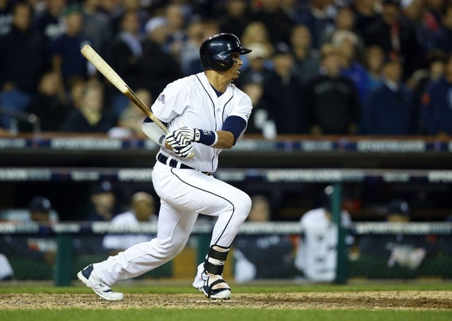 Oct 15, 2013; Detroit, MI, USA; Detroit Tigers designated hitter Victor Martinez (41) hits a single against the Boston Red Sox during the ninth inning in game three of the American League Championship Series baseball game at Comerica Park. Mandatory Credit: Rick Osentoski-USA TODAY Sports