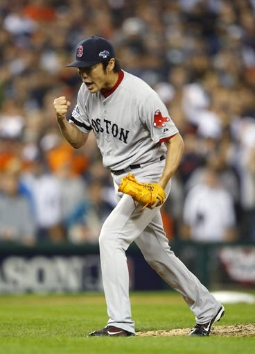 Oct 15, 2013; Detroit, MI, USA;  Boston Red Sox relief pitcher Koji Uehara (19) reacts after defeating the Detroit Tigers in game three of the American League Championship Series baseball game at Comerica Park. Boston won 1-0. Mandatory Credit: Rick Osentoski-USA TODAY Sports