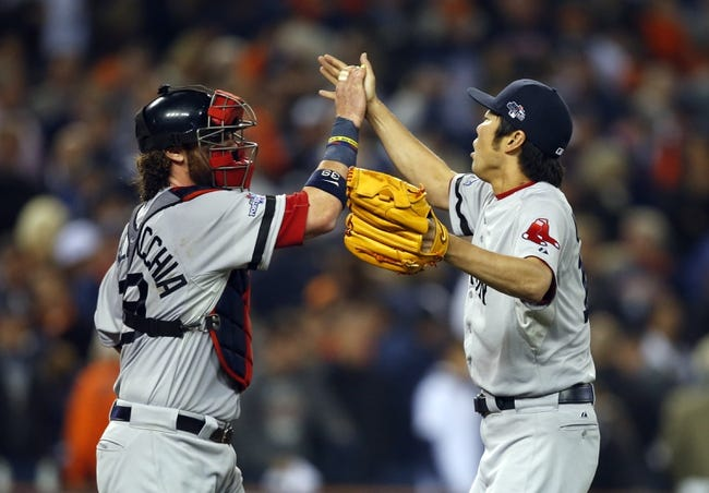 Oct 15, 2013; Detroit, MI, USA;  Boston Red Sox relief pitcher Koji Uehara (19) celebrates with catcher Jarrod Saltalamacchia (left) after defeating the Detroit Tigers 1-0 in game three of the American League Championship Series baseball game at Comerica Park. Mandatory Credit: Rick Osentoski-USA TODAY Sports