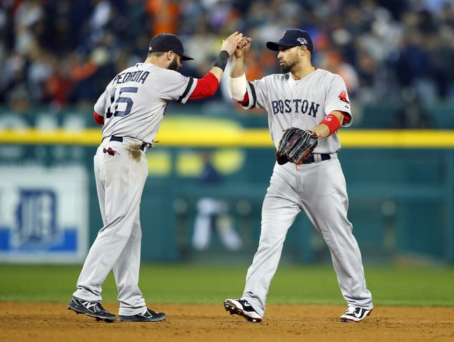 Oct 15, 2013; Detroit, MI, USA; Boston Red Sox second baseman Dustin Pedroia (15) and right fielder Shane Victorino (right) celebrate after defeating the Detroit Tigers 1-0 in game three of the American League Championship Series baseball game at Comerica Park. Mandatory Credit: Rick Osentoski-USA TODAY Sports