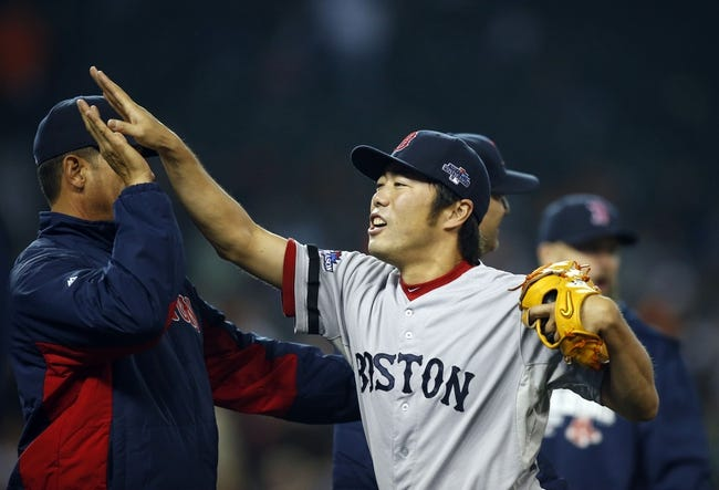 Oct 15, 2013; Detroit, MI, USA;  Boston Red Sox relief pitcher Koji Uehara (19) celebrates after defeating the Detroit Tigers 1-0 in game three of the American League Championship Series baseball game at Comerica Park. Mandatory Credit: Rick Osentoski-USA TODAY Sports