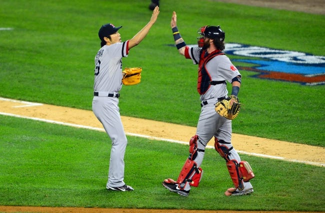 Oct 15, 2013; Detroit, MI, USA; Boston Red Sox relief pitcher Koji Uehara (19) and catcher Jarrod Saltalamacchia (39) celebrate after defeating the Detroit Tigers in game three of the American League Championship Series baseball game at Comerica Park. Boston won 1-0. Mandatory Credit: Andrew Weber-USA TODAY Sports