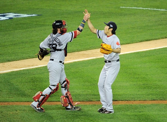 Oct 15, 2013; Detroit, MI, USA; Boston Red Sox relief pitcher Koji Uehara (19) and catcher Jarrod Saltalamacchia (39) react after defeating the Detroit Tigers in game three of the American League Championship Series baseball game at Comerica Park. Boston won 1-0.  Mandatory Credit: Tim Fuller-USA TODAY Sports