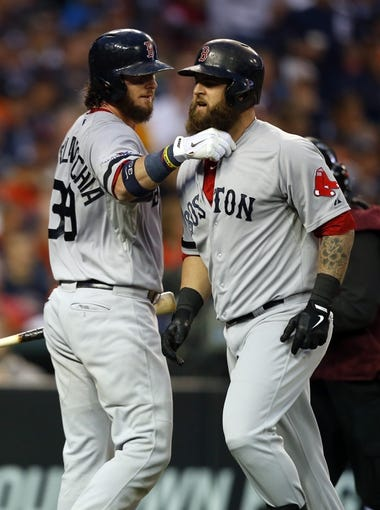Oct 15, 2013; Detroit, MI, USA;  Boston Red Sox first baseman Mike Napoli (12) celebrates his home run against the Detroit Tigers with catcher Jarrod Saltalamacchia (39) during the seventh inning in game three of the American League Championship Series baseball game at Comerica Park. Mandatory Credit: Rick Osentoski-USA TODAY Sports
