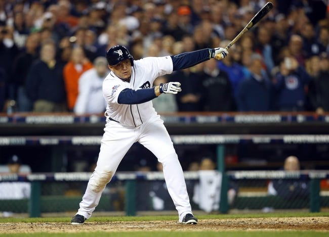 Oct 15, 2013; Detroit, MI, USA;  Detroit Tigers third baseman Miguel Cabrera (24) strikes out against the Boston Red Sox during the eighth inning in game three of the American League Championship Series baseball game at Comerica Park. Mandatory Credit: Rick Osentoski-USA TODAY Sports