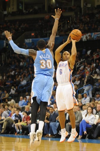 Oct 15, 2013; Oklahoma City, OK, USA; Oklahoma City Thunder point guard Derek Fisher (6) attempts a shot against Denver Nuggets small forward Quincy Miller (30) during the third quarter at Chesapeake Energy Arena. Mandatory Credit: Mark D. Smith-USA TODAY Sports