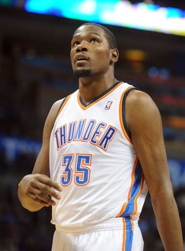 Oct 15, 2013; Oklahoma City, OK, USA; Oklahoma City Thunder small forward Kevin Durant (35) reacts to a play in action against the Denver Nuggets during the second quarter at Chesapeake Energy Arena. Mandatory Credit: Mark D. Smith-USA TODAY Sports