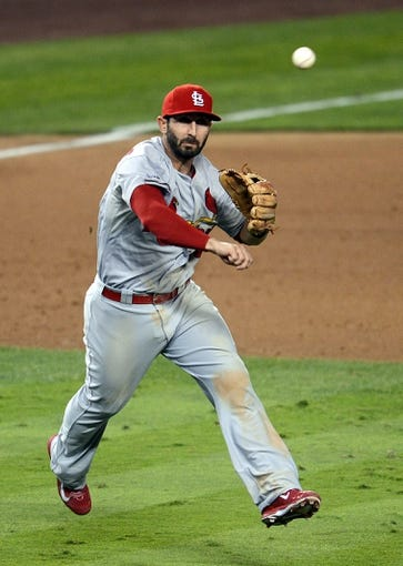 October 15, 2013; Los Angeles, CA, USA; St. Louis Cardinals shortstop Daniel Descalso (33) throws to first to complete an out in the eighth inning against the Los Angeles Dodgers  in game four of the National League Championship Series baseball game at Dodger Stadium. Mandatory Credit: Jayne Kamin-Oncea-USA TODAY Sports