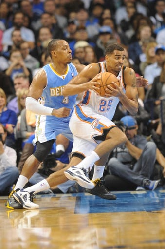 Oct 15, 2013; Oklahoma City, OK, USA; Oklahoma City Thunder shooting guard Thabo Sefolosha (25) handles the ball against Denver Nuggets point guard Randy Foye (4) during the second quarter at Chesapeake Energy Arena. Mandatory Credit: Mark D. Smith-USA TODAY Sports