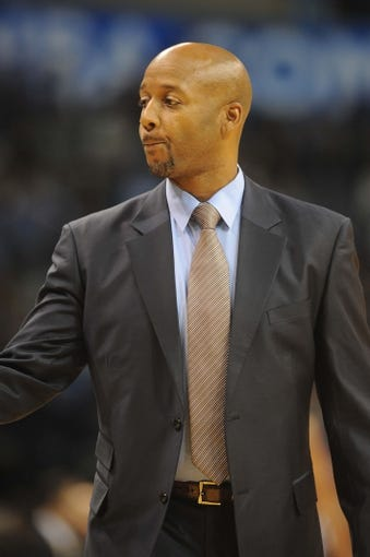 Oct 15, 2013; Oklahoma City, OK, USA; Denver Nuggets head coach Brian Shaw reacts to a call in action against the Oklahoma City Thunder during the second quarter at Chesapeake Energy Arena. Mandatory Credit: Mark D. Smith-USA TODAY Sports