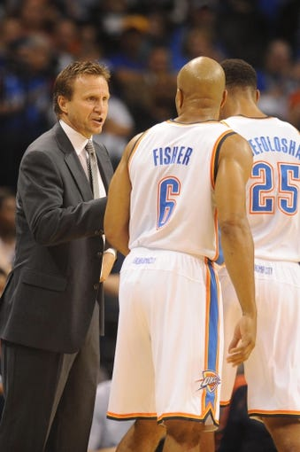 Oct 15, 2013; Oklahoma City, OK, USA; Oklahoma City Thunder head coach Scott Brooks talks to  Thunder point guard Derek Fisher (6) and  Thunder shooting guard Thabo Sefolosha (25) during a break in action against the Denver Nuggets at Chesapeake Energy Arena. Mandatory Credit: Mark D. Smith-USA TODAY Sports