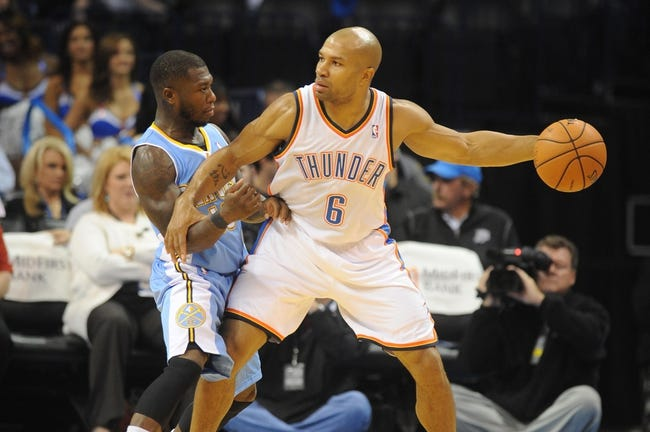 Oct 15, 2013; Oklahoma City, OK, USA; Oklahoma City Thunder point guard Derek Fisher (6) handles the ball against Denver Nuggets point guard Nate Robinson (10) during the fourth quarter at Chesapeake Energy Arena. Mandatory Credit: Mark D. Smith-USA TODAY Sports