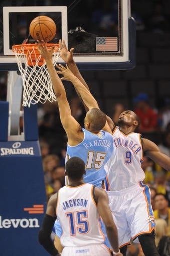 Oct 15, 2013; Oklahoma City, OK, USA; Denver Nuggets power forward Anthony Randolph (15) attempts a shot against Oklahoma City Thunder power forward Serge Ibaka (9) during the third quarter at Chesapeake Energy Arena. Mandatory Credit: Mark D. Smith-USA TODAY Sports