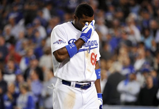 October 15, 2013; Los Angeles, CA, USA;  Los Angeles Dodgers right fielder Yasiel Puig (66 reacts after he grounds out into a double play in the ninth inning against the St. Louis Cardinals in game four of the National League Championship Series baseball game at Dodger Stadium. Mandatory Credit: Robert Hanashiro-USA TODAY Sports