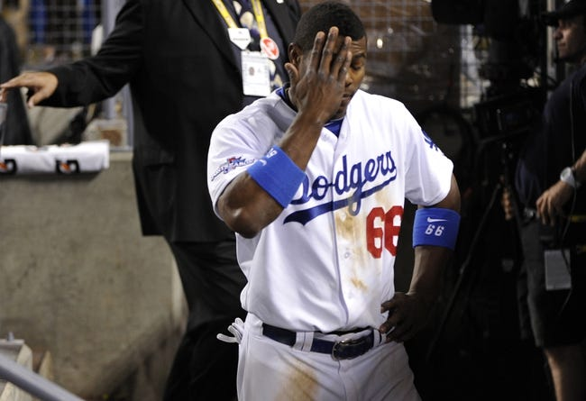 October 15, 2013; Los Angeles, CA, USA;  Los Angeles Dodgers right fielder Yasiel Puig (66) reacts following the 4-2 loss against the St. Louis Cardinals in game four of the National League Championship Series baseball game at Dodger Stadium. Mandatory Credit: Robert Hanashiro-USA TODAY Sports