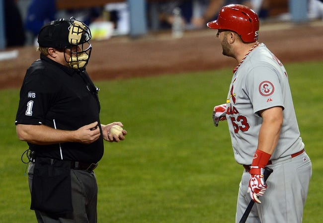 October 15, 2013; Los Angeles, CA, USA; St. Louis Cardinals first baseman Matt Adams (53) argues a strikeout call to umpire Bruce Dreckman in the ninth inning against the Los Angeles Dodgers  in game four of the National League Championship Series baseball game at Dodger Stadium. Mandatory Credit: Jayne Kamin-Oncea-USA TODAY Sports
