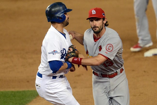 October 15, 2013; Los Angeles, CA, USA; Los Angeles Dodgers center fielder Andre Ethier (16) is tagged out by  St. Louis Cardinals second baseman Matt Carpenter (13) in the ninth inning  in game four of the National League Championship Series baseball game at Dodger Stadium. Mandatory Credit: Jayne Kamin-Oncea-USA TODAY Sports