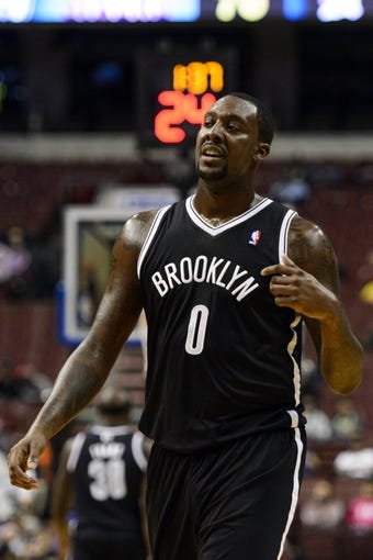 Oct 14, 2013; Philadelphia, PA, USA; Brooklyn Nets forward Andray Blatche (0) during the third quarter against the Philadelphia 76ers at Wells Fargo Center. The Nets defeated the Sixers 127-97. Mandatory Credit: Howard Smith-USA TODAY Sports