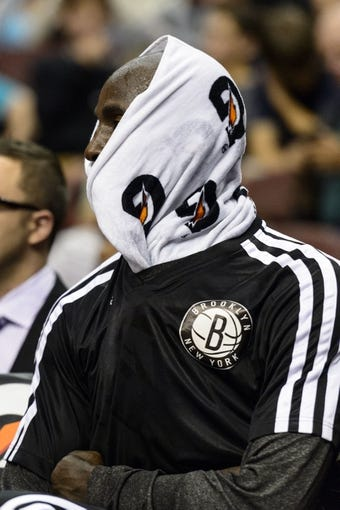Oct 14, 2013; Philadelphia, PA, USA; Brooklyn Nets forward Kevin Garnett (2) on the bench during the third quarter against the Philadelphia 76ers at Wells Fargo Center. The Nets defeated the Sixers 127-97. Mandatory Credit: Howard Smith-USA TODAY Sports