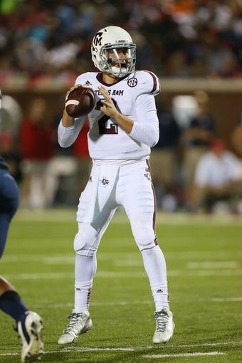 Oct 12, 2013; Oxford, MS, USA; Texas A&M Aggies quarterback Johnny Manziel (2) drops back to pass the ball during the game against the Mississippi Rebels at Vaught-Hemingway Stadium. Texas A&M Aggies defeated the Mississippi Rebels 41-48.  Mandatory Credit: Spruce Derden-USA TODAY Sports