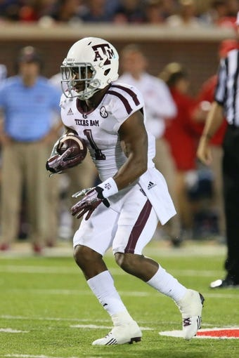 Oct 12, 2013; Oxford, MS, USA; Texas A&M Aggies running back Ben Malena (1) advances the ball during the game against the Mississippi Rebels at Vaught-Hemingway Stadium. Texas A&M Aggies defeated the Mississippi Rebels 41-48.  Mandatory Credit: Spruce Derden-USA TODAY Sports
