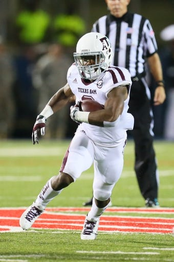 Oct 12, 2013; Oxford, MS, USA; Texas A&M Aggies running back Trey Williams (3) advances the ball during the game against the Mississippi Rebels at Vaught-Hemingway Stadium. Texas A&M Aggies defeated the Mississippi Rebels 41-48.  Mandatory Credit: Spruce Derden-USA TODAY Sports