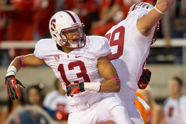 Oct 12, 2013; Salt Lake City, UT, USA; Stanford Cardinal wide receiver Rollins Stallworth (13) and wide receiver Devon Cajuste (89) celebrate Cajuste's touchdown during the second half against the Utah Utes at Rice-Eccles Stadium. Utah defeated Stanford 27-21. Mandatory Credit: Russ Isabella-USA TODAY Sports