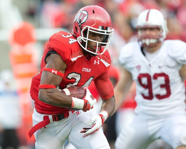Oct 12, 2013; Salt Lake City, UT, USA; Utah Utes running back James Poole (34) runs with the ball during the first half against the Stanford Cardinal at Rice-Eccles Stadium. Utah defeated Stanford 27-21. Mandatory Credit: Russ Isabella-USA TODAY Sports