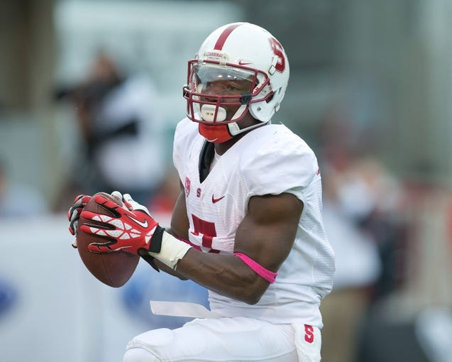 Oct 12, 2013; Salt Lake City, UT, USA; Stanford Cardinal wide receiver Ty Montgomery (7) fields a kickoff during the first half against the Utah Utes at Rice-Eccles Stadium. Utah defeated Stanford 27-21. Mandatory Credit: Russ Isabella-USA TODAY Sports