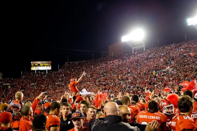 Oct 12, 2013; Salt Lake City, UT, USA; Utah Utes quarterback Travis Wilson (7) is hoisted onto the shoulders of teammates during a celebration following a 27-21 defeat of the Stanford Cardinal at Rice-Eccles Stadium. Mandatory Credit: Russ Isabella-USA TODAY Sports