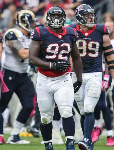 Oct 13, 2013; Houston, TX, USA; Houston Texans nose tackle Earl Mitchell (92) reacts after a play during the second quarter against the St. Louis Rams at Reliant Stadium. Mandatory Credit: Troy Taormina-USA TODAY Sports