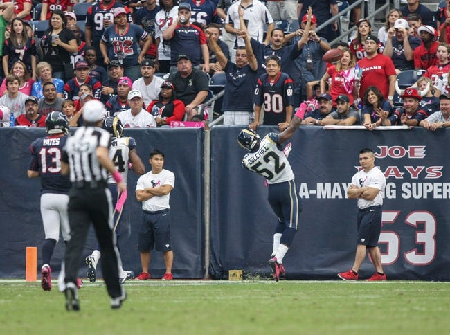 Oct 13, 2013; Houston, TX, USA; St. Louis Rams outside linebacker Alec Ogletree (52) throws a ball into the stands after scoring a touchdown during the third quarter against the Houston Texans at Reliant Stadium. Mandatory Credit: Troy Taormina-USA TODAY Sports