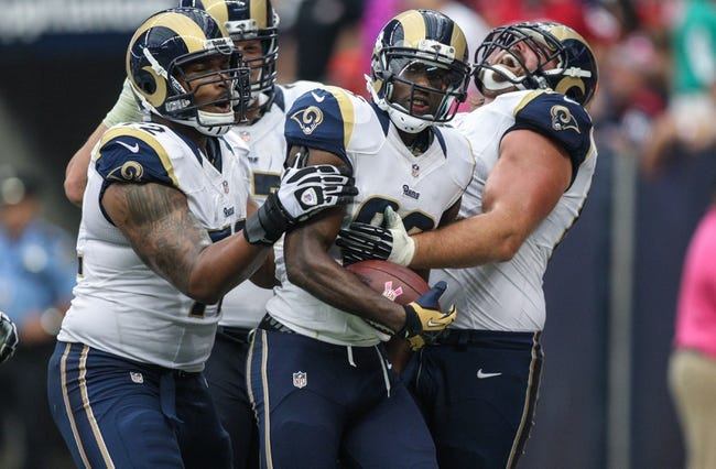 Oct 13, 2013; Houston, TX, USA; St. Louis Rams wide receiver Brian Quick (83) is congratulated after scoring a touchdown during the third quarter against the Houston Texans at Reliant Stadium. The Rams defeated the Texans 38-13. Mandatory Credit: Troy Taormina-USA TODAY Sports