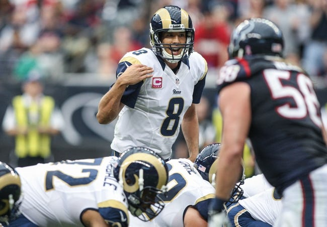 Oct 13, 2013; Houston, TX, USA; St. Louis Rams quarterback Sam Bradford (8) calls a play during the second quarter against the Houston Texans at Reliant Stadium. Mandatory Credit: Troy Taormina-USA TODAY Sports